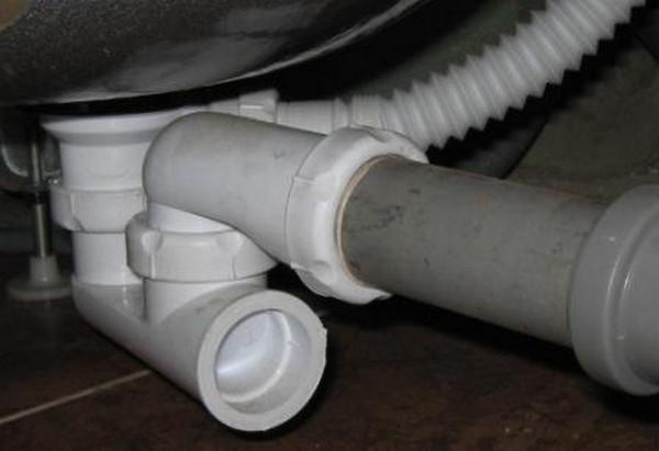 замена сифона душевой кабины с низким поддоном фото